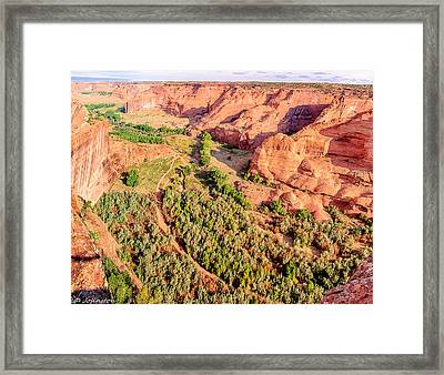 Miles To Go In Canyon De Chelly Framed Print by Bob and Nadine Johnston