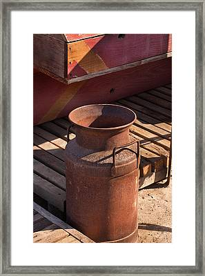 Milk Can With Red Boxes Framed Print by Art Block Collections