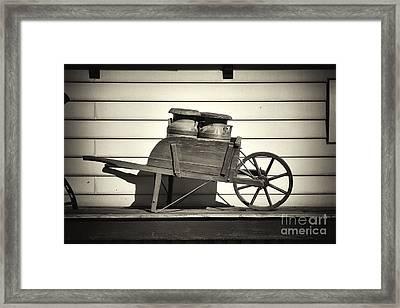 Milk Jugs In A Wheelbarrow Framed Print by George Oze