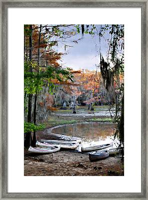 Mill Pond Canoes Framed Print by Lana Trussell