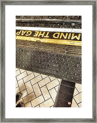Mind The Gap Framed Print