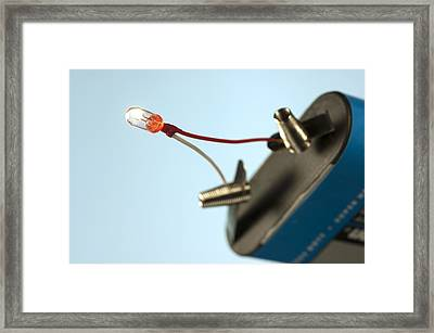 Miniature Light Bulb And Battery Framed Print by Science Photo Library