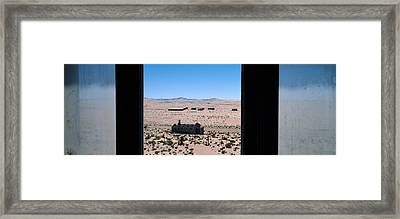Mining Town Viewed Through A Window Framed Print by Panoramic Images