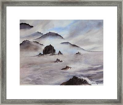 Mists Of Haystack Rock Framed Print