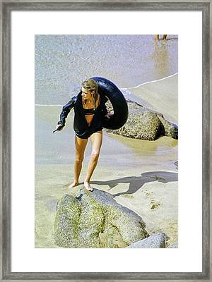 Model Carrying An Inflatable Tube And Gun Framed Print