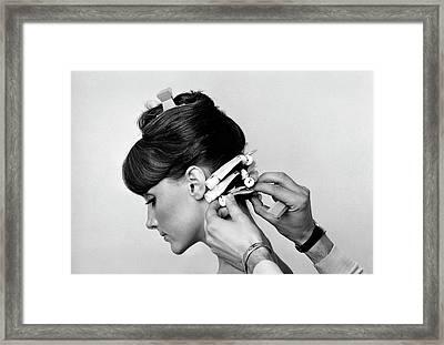 Model Getting Her Hair Curled Framed Print