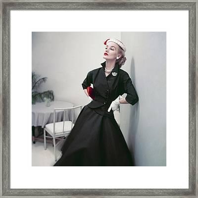 Model In A Black Suit Framed Print