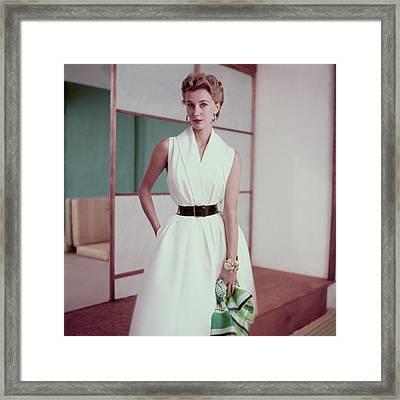 Model In A White Dress Framed Print