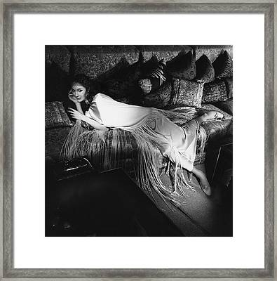 Model Lying On A Couch In A Antonelli Poncho Framed Print