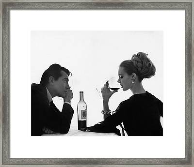 Man Gazing At Woman Sipping Wine Framed Print by Bert Stern