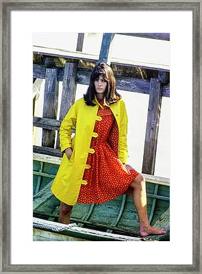 Model On A Boat In A Yellow Over Coat And A Red Framed Print