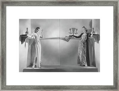 Model On Left Wearing A Dinner Dress Framed Print