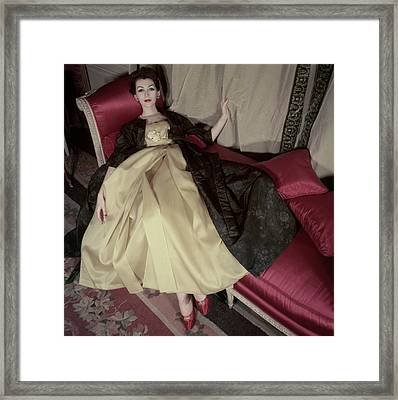 Model Reclining In An Evening Dress And Coat Framed Print