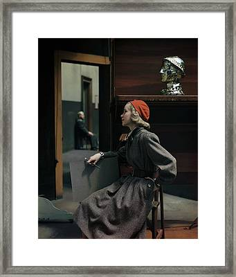 Model Sitting In A Tweed Dress And Red Hat Framed Print