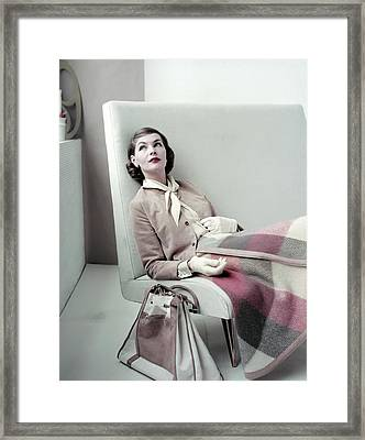 Model Sitting In Chair Wearing Plaid Skirt Framed Print