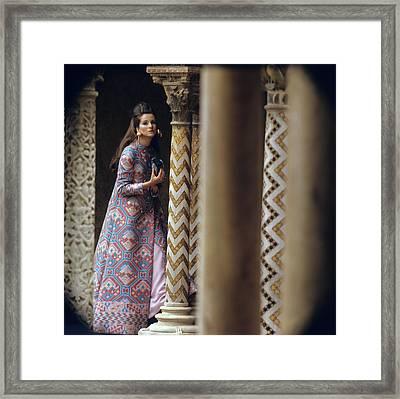 Model Stands Beside A Mosaic Column Wearing Framed Print