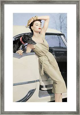 Model Wearing A Kidskin Dress Leaning On A Car Framed Print by Richard Rutledge
