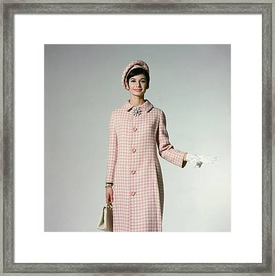 Model Wearing A Pink Hounds Tooth Coat Framed Print