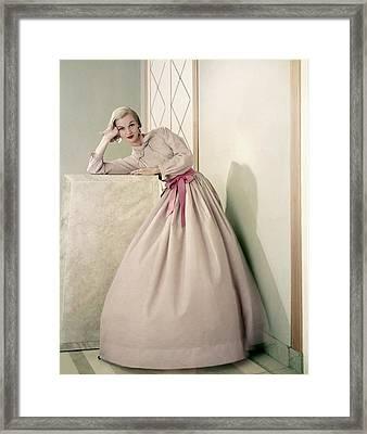 Model Wearing A Pink Shirt And Full Skirt Framed Print