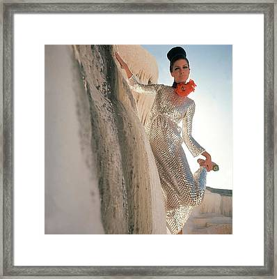 Model Wearing A Silver Sequined Dress By Anne Framed Print