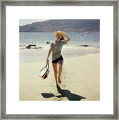 Model Wearing A Straw Hat On A Beach Framed Print