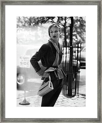 Model Wearing A Suit And Holding Purse Framed Print