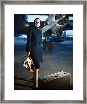 Model Wearing Ceil Chapman Coat At Airport Framed Print