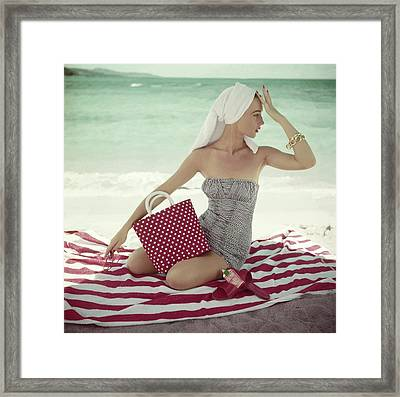 Model With A Polka Dot Bag On A Beach Framed Print by Roger Prigent