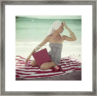 Model With A Polka Dot Bag On A Beach Framed Print