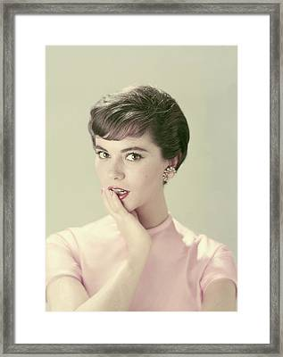 Model With Her Hand On Her Chin Framed Print