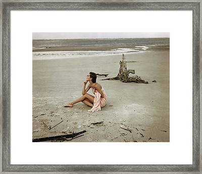 Model Wrapped In A Pink Towel On The Beach Framed Print