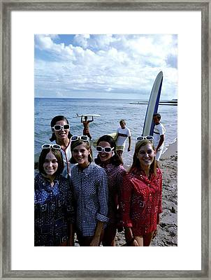 Models And Surfers On A Beach Framed Print
