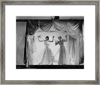 Models As Marionettes Framed Print