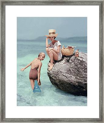 Models At A Beach Framed Print by Richard Rutledge