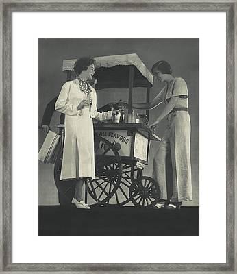 Models Beside A Hot Dog Wagon Framed Print