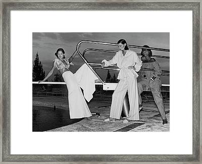 Models By A Diving Board Framed Print