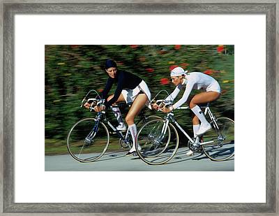 Models Cycling In Headscarves Framed Print