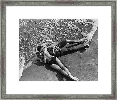 Models Embracing On A Beach Framed Print