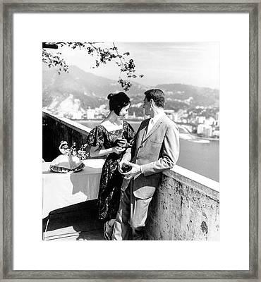 Models Holding Wine On A Balcony Framed Print by Richard Waite