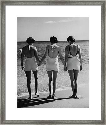 Models On A Beach Framed Print by Toni Frissell