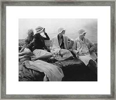 Models On A Yacht Framed Print
