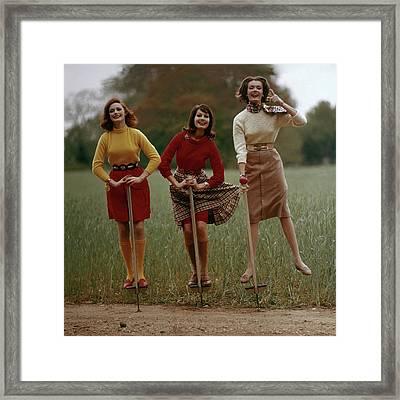 Models On Pogo Sticks Framed Print