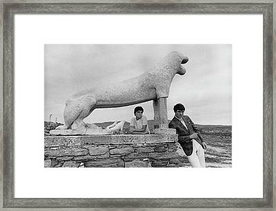 Models Posing By A Sculpture Of A Lion Framed Print by Leonard Nones