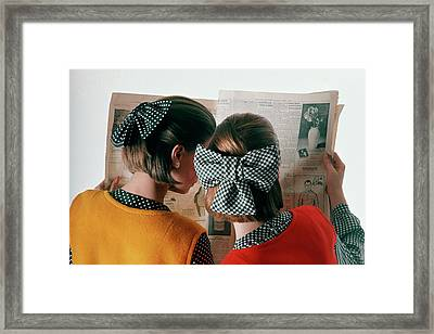 Models Reading Newspaper Framed Print