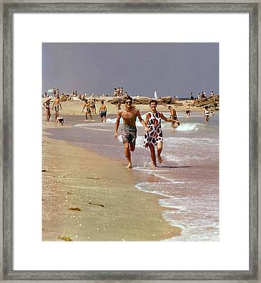 Models Running On A Beach Framed Print by William Connors