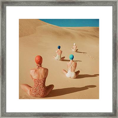 Models Sitting On Sand Dunes Framed Print by Clifford Coffin