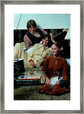 Models Watching Television Framed Print