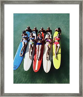 Models Wearing Bikinis Lying On Surfboards Framed Print