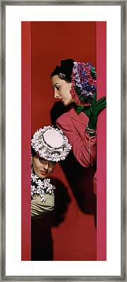 Models Wearing Hats Framed Print by John Rawlings