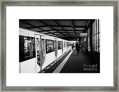 modern yellow u-bahn train sitting at station platform Berlin Germany Framed Print by Joe Fox